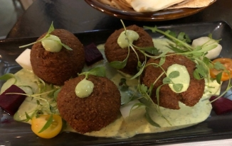 Falafel with herbed labneh yogurt dipping sauce